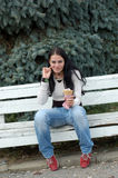 Woman eating ice-cream Stock Images