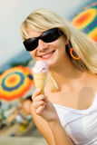 Woman eating ice-cream Stock Photography
