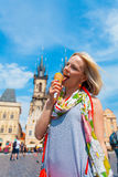 Woman eating ice cream on a background of Tyn Cathedral Royalty Free Stock Images