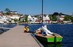 Woman Eating Ice Cream in the Harbour of Grimstad Stock Photography