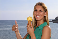 Woman eating ice-cream Royalty Free Stock Photography