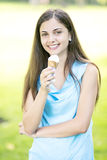 Woman eating ice cream Royalty Free Stock Photos