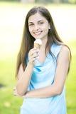 Woman eating ice cream royalty free stock photos