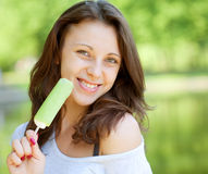 Woman eating ice-cream sunny day outdoors Royalty Free Stock Image