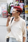 Woman eating icecream Royalty Free Stock Image