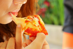 Woman eating Italian pizza ham cheese Royalty Free Stock Photos