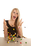 Woman eating jelly beans and throwing them Royalty Free Stock Photography