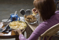 Woman eating junk food_2 Royalty Free Stock Image
