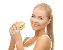 Woman eating junk food. Picture of healthy woman eating junk food royalty free stock images