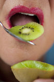 Woman Eating Kiwi Fruit Royalty Free Stock Images