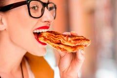 Woman eating lasagna outdoors Stock Photography