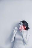 Woman eating lemon feel sour Stock Images