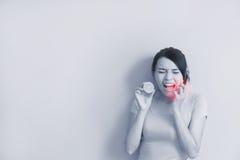 Woman eating lemon feel sour Royalty Free Stock Images