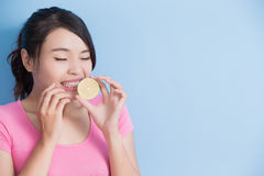 Woman eating lemon feel sour Stock Image