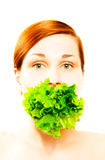 Woman eating lettuce Stock Photos