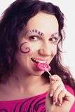 Woman eating a lollipop Royalty Free Stock Photos