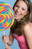 Woman Eating Lollipop Stock Photos