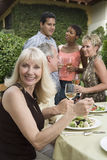 Woman Eating Lunch With Friends Stock Photography