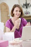 Woman eating lunch at her desk Royalty Free Stock Photos