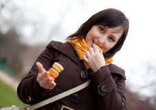 Woman eating macaroons Royalty Free Stock Images