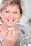 Woman eating marshmallows Stock Photos
