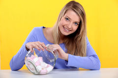 Woman eating marshmallows Royalty Free Stock Photos