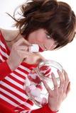 Woman eating marshmallows Royalty Free Stock Image