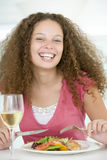 Woman Eating meal, mealtime With A Glass Of Wine Stock Photo