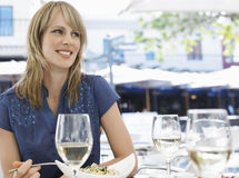Woman Eating Meal At Outdoor Cafe Stock Images