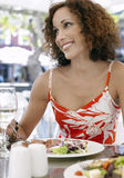 Woman Eating Meal At Outdoor Cafe Stock Photo