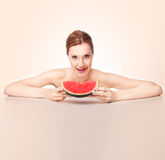 Woman eating melon Royalty Free Stock Photos