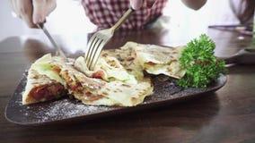 Woman eating mexican vegetarian quesadilla. Close up stock footage