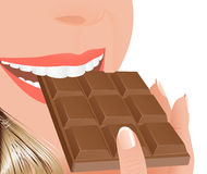 Woman eating milk chocolate Royalty Free Stock Photography