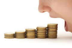 Woman eating money Royalty Free Stock Images