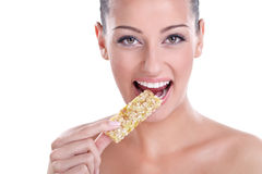 Woman eating muesli bar snack. Young healthy woman eating muesli bar snack Stock Image
