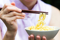 Woman eating noodle Royalty Free Stock Image