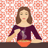 Woman eating noodles Royalty Free Stock Photos