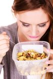 Woman eat oatmeal with dry fruits. Dieting stock images