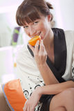 Woman eating orange Royalty Free Stock Photo
