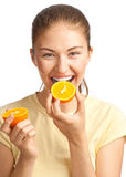 Woman eating orange royalty free stock images