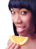 Woman eating an orange Royalty Free Stock Photos