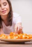 Woman eating oranges. Stock Photo