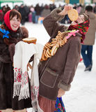 Woman eating pancake during  Shrovetide Royalty Free Stock Image
