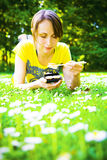 Woman eating in park Stock Image