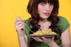 A woman eating pasta. For lunch Royalty Free Stock Images