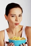 Woman eating pasta from a bowl. Royalty Free Stock Photography
