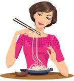 Woman eating pasta. A woman eating italian food pasta Royalty Free Stock Photography