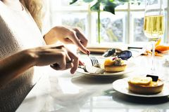 Woman is eating pastry at the restaurant royalty free stock photo