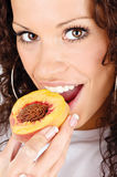 Woman eating peach Royalty Free Stock Photography
