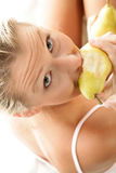 Woman eating pear Royalty Free Stock Images